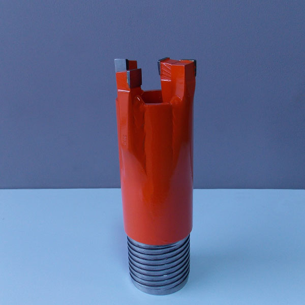 Drill starter bit with one carbide tooth slightly angled inwards to break up the core and prevent clogging