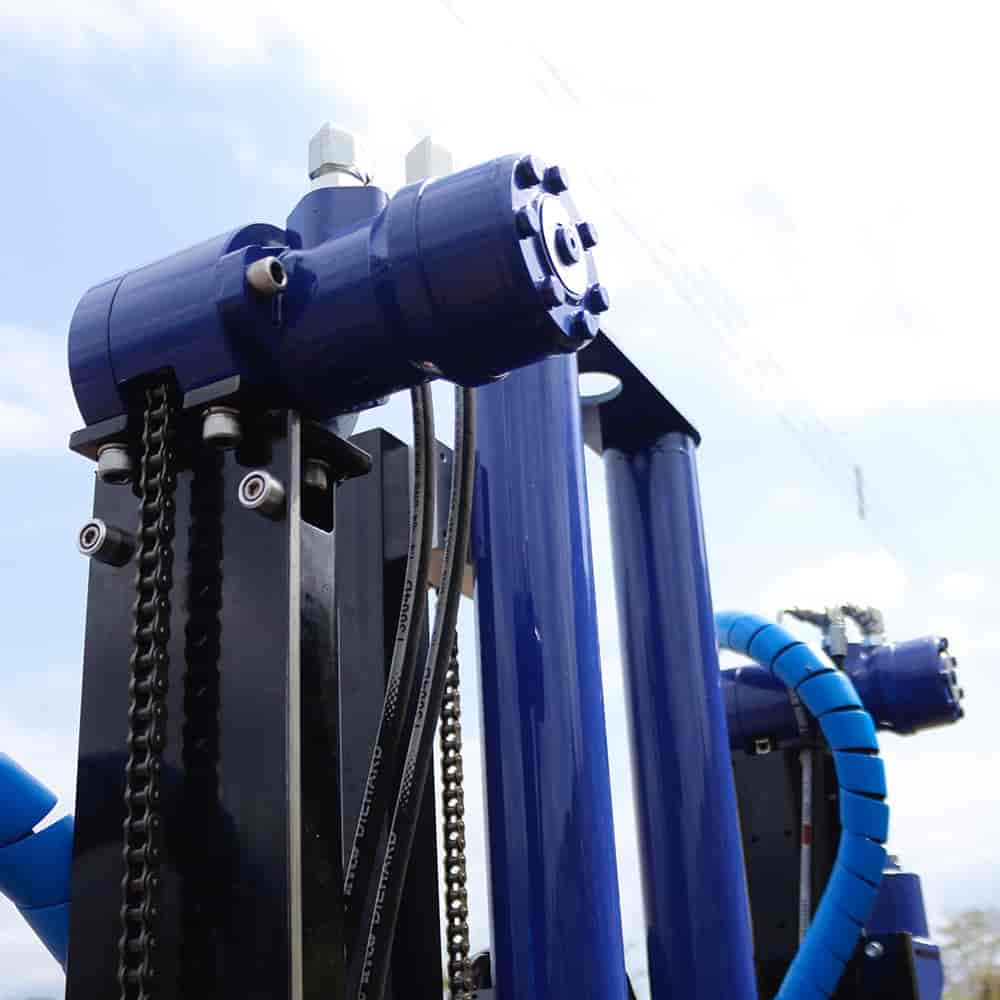 Chain driven auger anchoring system for the CPT cone testing drill rig