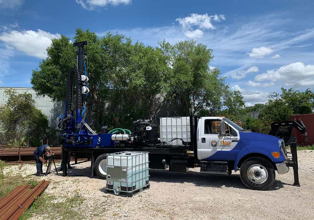 Drill rigs mounted on flatbed truck for spt testing and rotary core drilling.