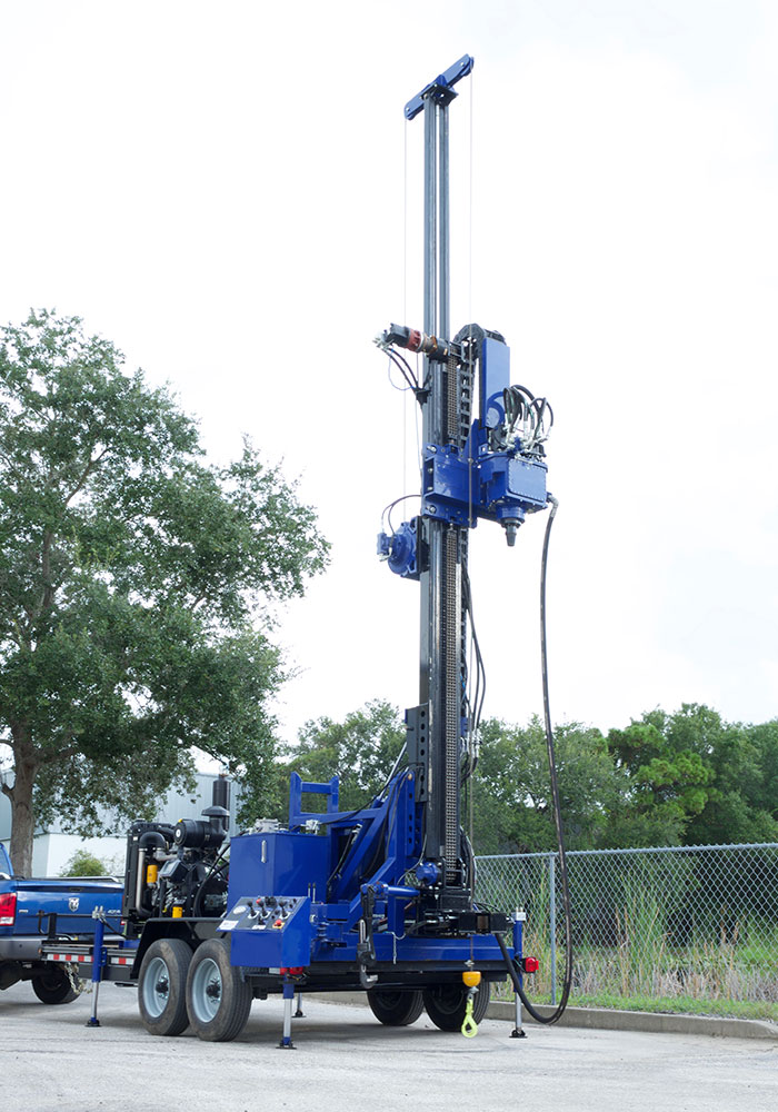 This new water well drill rig, comes mounted on a trailer that can be towed by a pick-up truck.